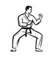 karate symbol man in kimono stands in fighting vector image vector image