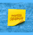 merry christmas text on yellow sticky note paper vector image vector image