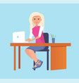 woman typing on laptop sitting at table vector image