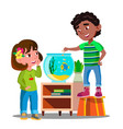 afro american boy and white girl whatch and feed vector image
