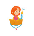 girl sitting on rhe floor and reading a book vector image vector image