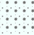 seamless pattern of snowflakes on a white vector image