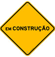 Yellow and black em construcao sign vector image vector image