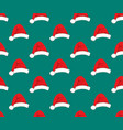 red santa hat on green teal background vector image
