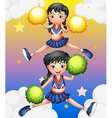 Two cheerdancers dancing with their pom poms vector image