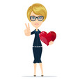 attractive young blonde showing red heart on white vector image vector image