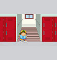boy at school stairs reading a book vector image