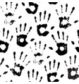seamless pattern black handprints on white vector image