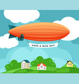 airship over village festive orange vector image