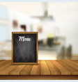 chalkboard menu on a table against a defocussed vector image