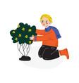 teen boy planting flowering plant kids spring or vector image vector image