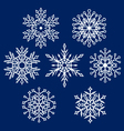 white silhouettes of snowflake vector image vector image