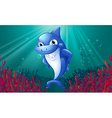 A blue shark smiling under the sea vector image vector image