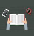 male hands holding a book vector image vector image