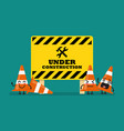Under construction sign and traffic cones