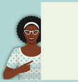 smiling retro black woman points at blank poster vector image vector image