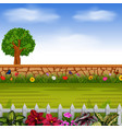stone wall with the tall tree and flowers vector image