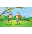 A boy and a girl playing in the hills vector image vector image