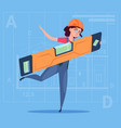 cartoon woman builder holding carpenter level vector image