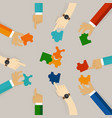 team work hand holding pieces of jigsaw puzzle try vector image