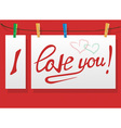 inscription on paper I love you and clothespins vector image