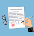 man signs a business contract paper document