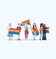 women group holding rainbow flag love parade lgbt vector image vector image