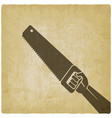 hand ith saw on vintage background vector image