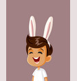 cute happy boy with bunny ears celebrating easter vector image