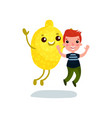 cute little boy having fun with giant lemon fruit vector image