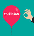 hand pushing needle to pop business balloon vector image