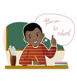 happy small african american boy at desk vector image