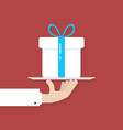 hand holding big white gift box on plate vector image