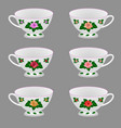 set of white tea cups ornate with rose flowers vector image