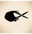 hand with scissors vector image