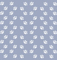 white cats paw on an lilac background vector image