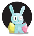 blue bunny with blue and pink egg in front of vector image vector image