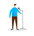 young man in blue shirt standing with microphone vector image