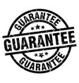 guarantee round grunge black stamp vector image vector image