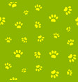 seamless pattern paws on green vector image vector image