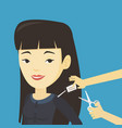 woman cutting price tag off new t-shirt vector image