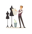 male fashion designer standing near the dummy vector image vector image