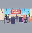 businesspeople sitting at workplaces with laptops vector image vector image