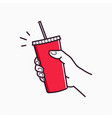 hand hold paper cup male hand holding a red paper vector image vector image