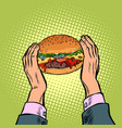 hands holding a burger fast food restaurant vector image vector image