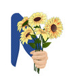 yellow coreopsis in the hand vector image vector image