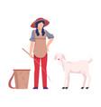 asian female farmer tending sheeps