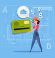 cartoon woman builder hold credit card sell house vector image vector image