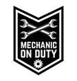 mechanic on duty emblem template with crossed vector image vector image