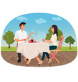 a couple sitting in the cafe outside having a vector image